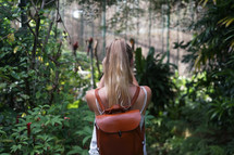 a woman backpacking in the jungle