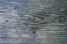 scratched and weathered wood board