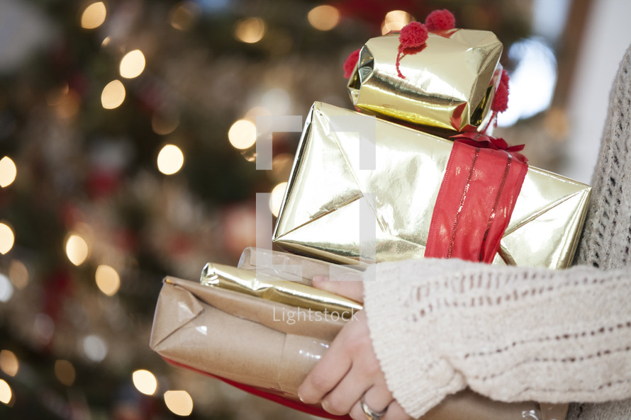 A woman holding Christmas gifts