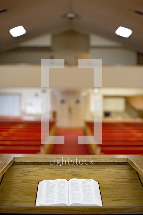 Bible on the Pulpit in a Church Auditorium