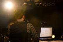 Man playing keyboard during worship