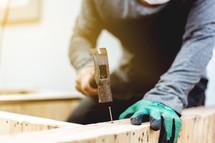 man hammering a nail