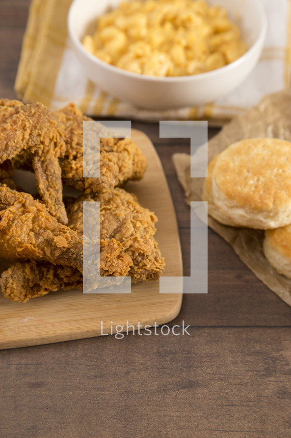 biscuits and Classic Southern Fried Chicken on a Wood Table