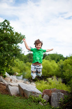a child jumping in the air