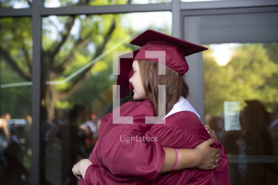 hugs on graduation day