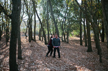 A couple in love standing in a forest.