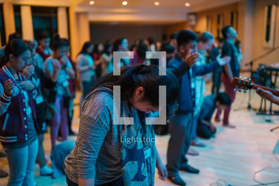 teens at a worship service