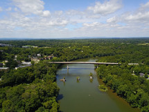 aerial view over a river and bridge