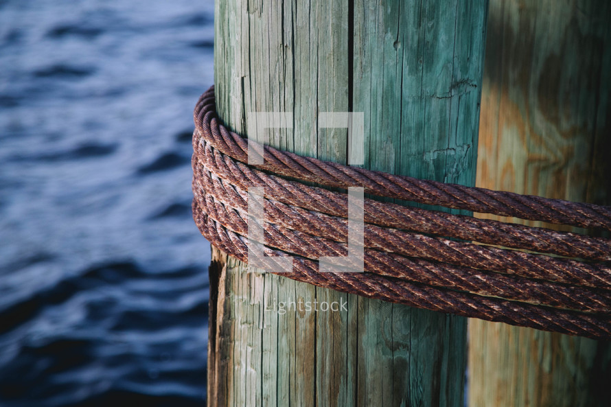 steel metal rope around a pier pillar