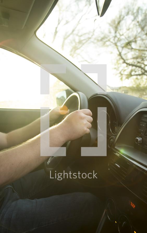 hands on a steering wheel