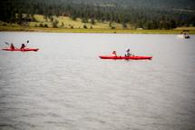 paddling in kayaks