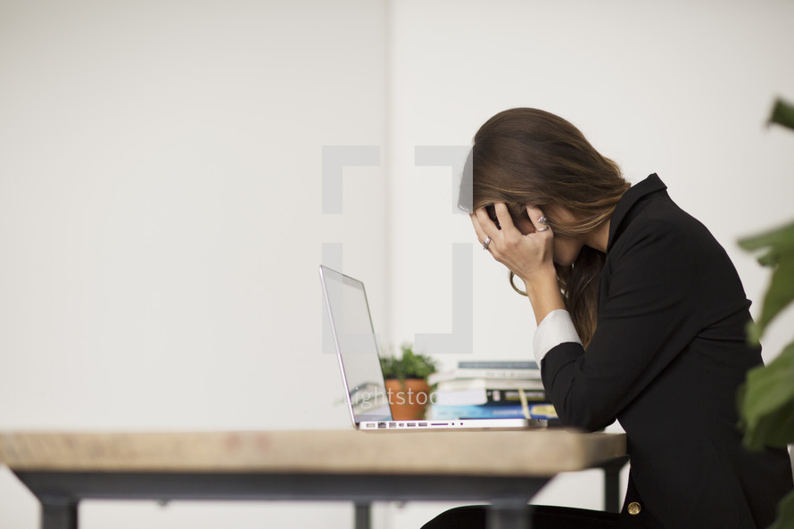 a stressed out businesswoman behind her desk