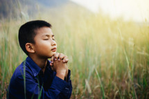 boy with praying hands