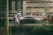 pedestrians walking in the rain