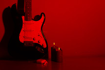 electric guitar and candles
