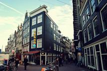 A busy, pedestrian filled city street.