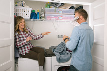 couple having fun while doing laundry
