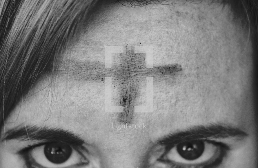cross Ashes on a woman's forehead