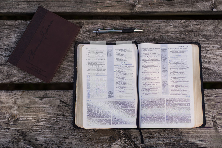 pen, journal, and open Bible