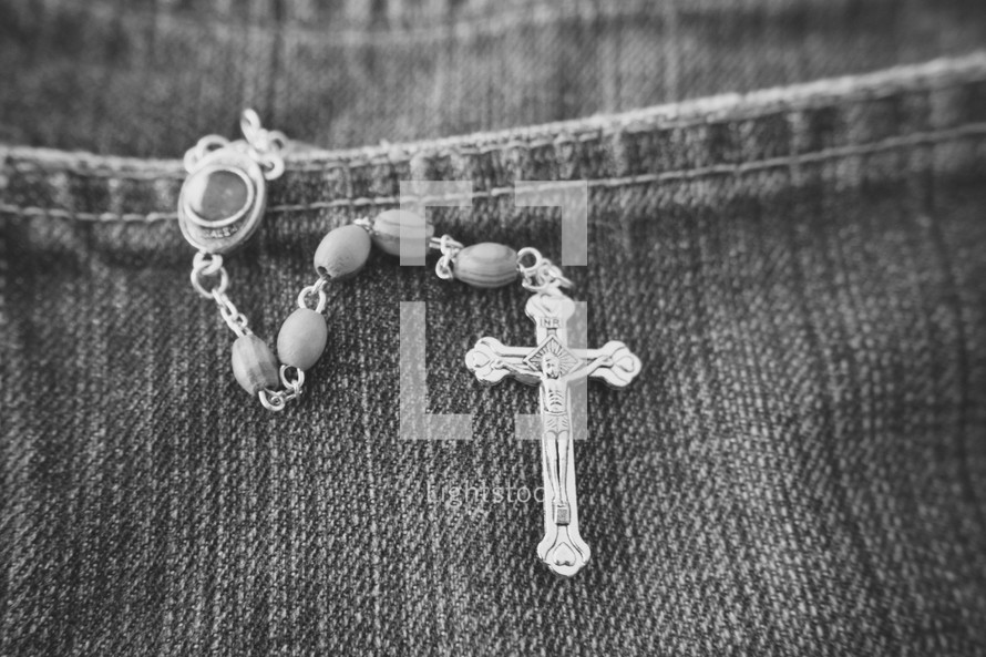 rosary in a jeans pocket