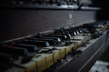 ashes on an old piano