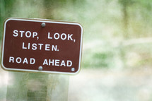 """A brown sign reading, """"Stop, Look, Listen.  Road Ahead."""""""