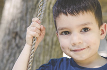 a kid on a rope swing