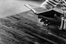man's hands holding a Bible