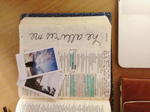 polaroid pictures on the pages of a Bible
