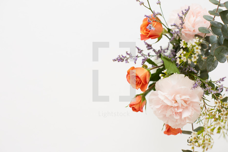 orange roses in a floral arrangement