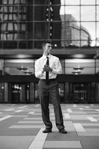 a business man standing in a courtyard