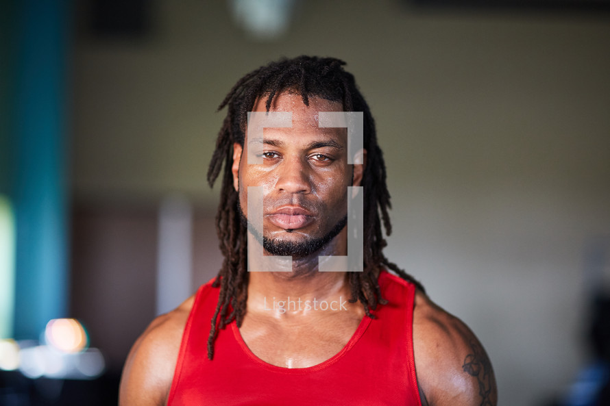 head shot of a sweaty man at the gym