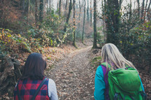 women hiking on a nature trail