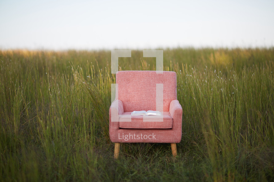 Bible In A Chair In A Field Of Tall Grass Photo Lightstock