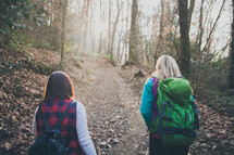 women walking on a nature trail