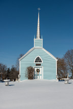 blue church in snow