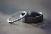 wedding bands laying on top of one another.