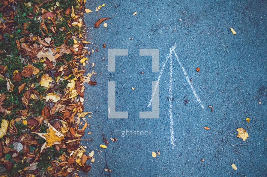 arrow on a paved path
