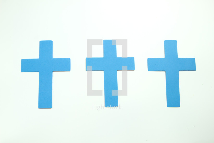three blue crosses on a white background