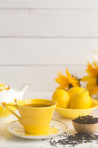 Bright Yellow Tea Set on a White Wood Table
