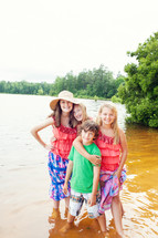 siblings standing in lake water