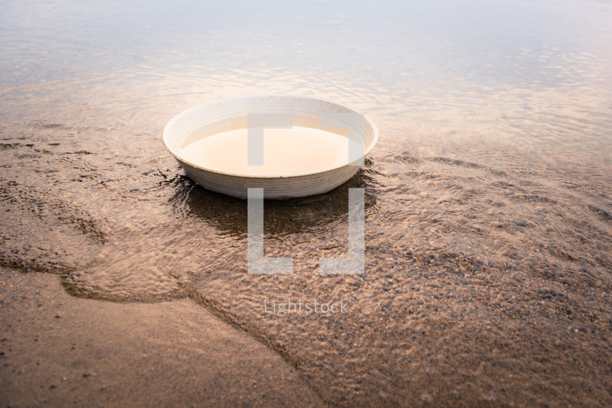 bowl of water in the sand