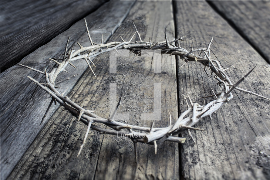 a crown of thorns on wood boards