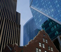 tall city buildings over a brick structure