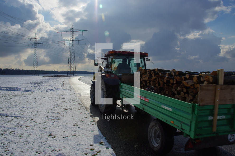 a tractor pulling logs