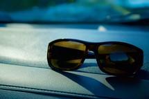 sunglasses on a dashboard