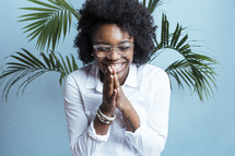 young African American female model with hands in prayer