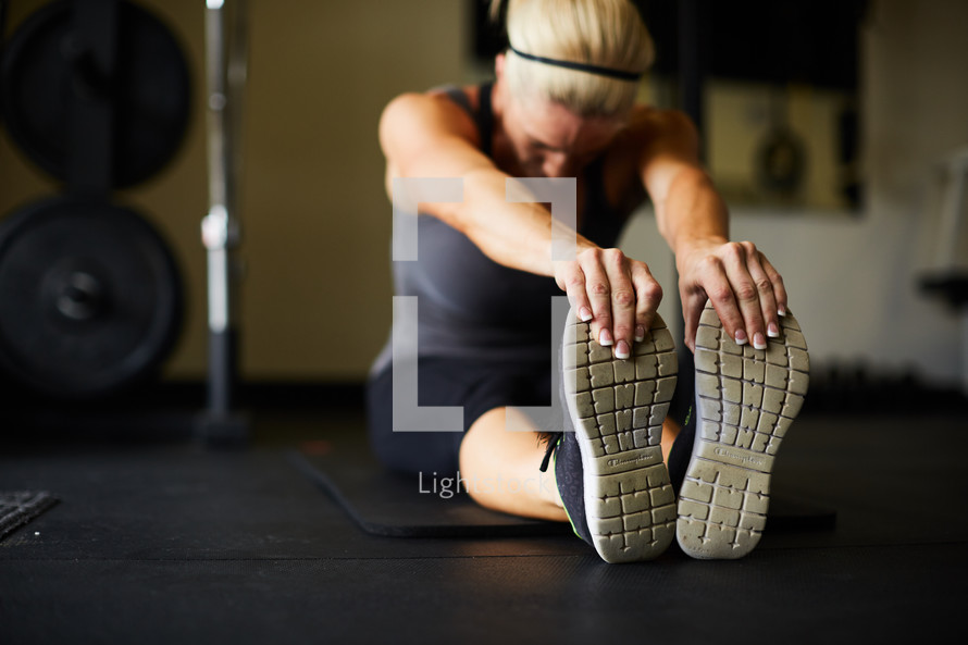 a woman stretching in a gym