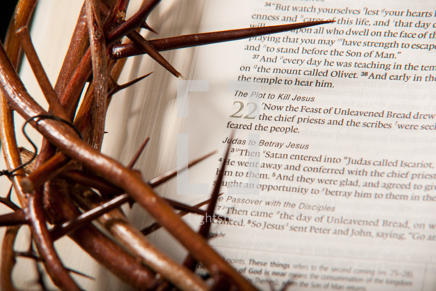 Crown of thorns on top of Bible open to Luke 22 -- The Plot to Kill Jesus.