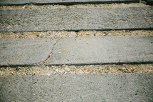 sandy spaces between concrete slabs